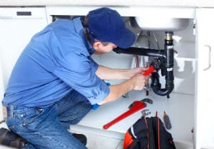 plumbing contractor handling an emergency leak in Fullerton, CA