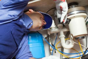 plumber repairing a broken garbage disposal in Mission Viejo, CA